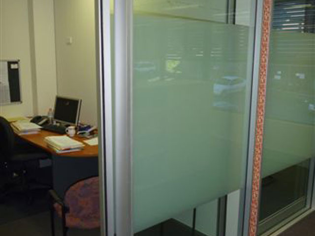 Newcastle Window Tinting - pattern graphic on internal office partition for privacy